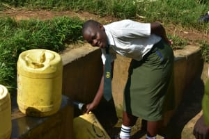 The Water Project: ACK St. Peter's Khabakaya Secondary School -  Student Fetching Water At The Spring
