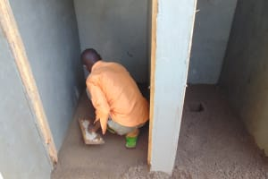 The Water Project: Musasa Primary School -  Cementing Inside Of Latrines Floors