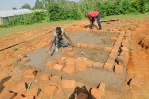 The Water Project: Shinyikha Primary School -  Brickwork Laid Over Cement Latrine Foundation