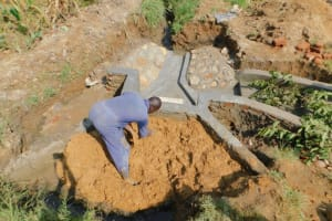 The Water Project: Sichinji Community, Kubai Spring -  Backfilling With Clay