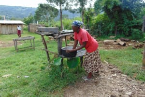 The Water Project: Friends School Ikoli Secondary -  School Cook Washing Utensils At The Dishrack