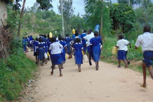 The Water Project: Mutiva Primary School -  Students Heading To Collect Water