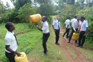 The Water Project: Friends Mixed Secondary School Lwombei -  Taking A Sip On The Walk Back