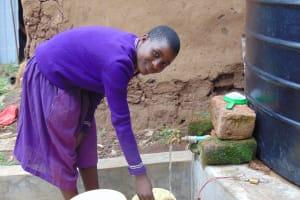 The Water Project: Kapsogoro Primary School -  Student Fetching Water