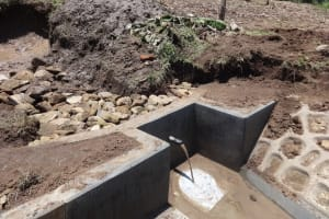 The Water Project: Bungaya Community, Charles Khainga Spring -  Backfilling With Stones As Water Starts To Flow