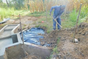 The Water Project: Sichinji Community, Kubai Spring -  Backfilling With Soil
