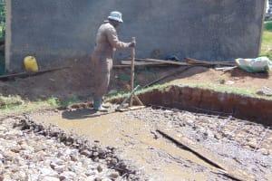 The Water Project: Musasa Primary School -  Adding Concrete To Rain Tank Foundation