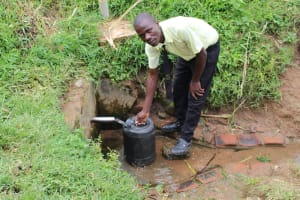 The Water Project: St. Gerald Mayuge Secondary School -  Student Collecting Water
