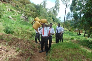 The Water Project: Friends Mixed Secondary School Lwombei -  Students Hauling Water