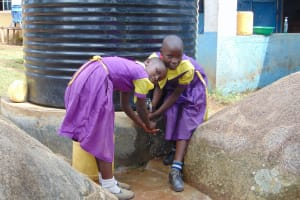 The Water Project: Kapsogoro Primary School -  Students Using Water At The Storage Tank