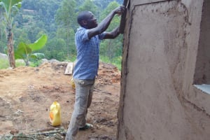 The Water Project: Musasa Primary School -  Cementing Latrine Walls