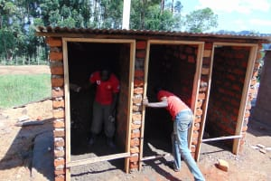 The Water Project: Goibei Primary School -  Working Inside Latrine Walls