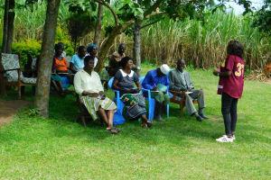 The Water Project: Bung'onye Community, Shilangu Spring -  Training Under Tree Shade
