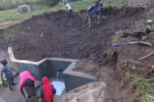 The Water Project: Bungaya Community, Charles Khainga Spring -  Soil Layer Backfilling