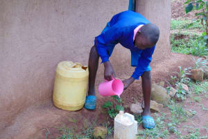 The Water Project: Kapsaoi Primary School -  Student Collecting Water From Home