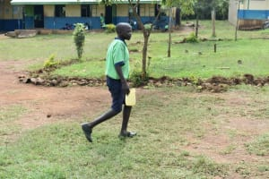 The Water Project: Khwihondwe SA Primary School -  Student Carrying Water