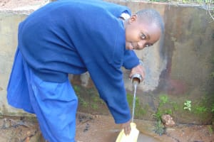 The Water Project: Mutiva Primary School -  Student Fetching Water