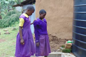 The Water Project: Kapsogoro Primary School -  Students Collecting Water