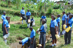 The Water Project: Malinda Secondary School -  Students Line Up To Collect Water