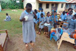 The Water Project: Womulalu Special School -  Cynthia Brushes Her Teeth