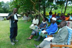 The Water Project: Bung'onye Community, Shilangu Spring -  Community Member Using Training Materials