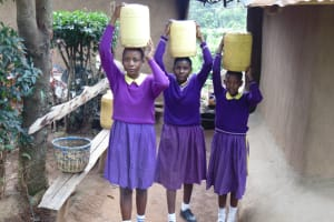 The Water Project: Kapsogoro Primary School -  Students Carrying Water