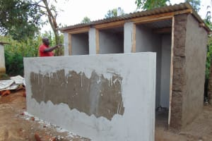The Water Project: Mukangu Primary School -  Plastering The Latrines