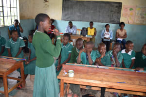 The Water Project: Elufafwa Community School -  Student Demonstrates Toothbrushing