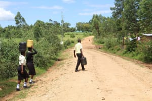 The Water Project: St. Gerald Mayuge Secondary School -  Students Carrying Water