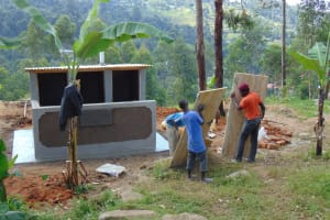 The Water Project: Musasa Primary School -  Adding The Latrine Doors