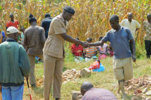 The Water Project: Sichinji Community, Kubai Spring -  The Assistant Chief Shakes Hands With A Community Member