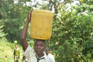 The Water Project: ACK St. Peter's Khabakaya Secondary School -  Student Carrying Water