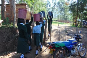 The Water Project: Friends Kuvasali Secondary School -  Students Carrying Water Through The School Gate