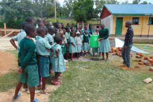 The Water Project: Mukangu Primary School -  Student Leads Handwashing Practice