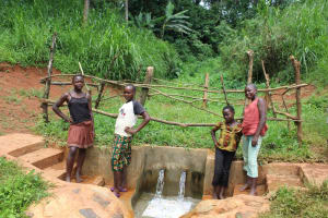The Water Project: Mushina Community, Shikuku Spring -  Girls Pose With The Spring