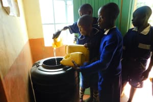 The Water Project: Makale Primary School -  Combining Water For Storage