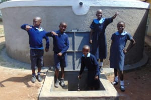 The Water Project: Enyapora Primary School -  Students Pose With Rain Tank