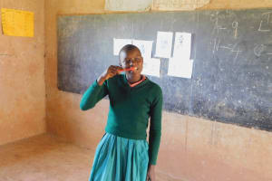 The Water Project: Shinyikha Primary School -  Student Demonstrates Toothbrushing