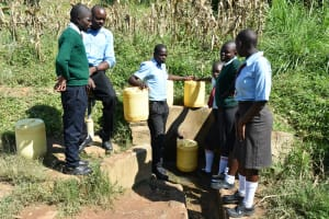 The Water Project: Ebubole UPC Secondary School -  Students Collecting Water