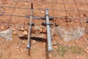 The Water Project: Goibei Primary School -  Tap Pipe For Access And Score System For Draining The Tank