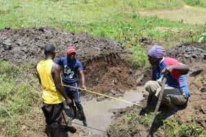 The Water Project: Emmachembe Community, Magina Spring -  Taking Measurements During Excavation