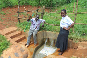The Water Project: Mushina Community, Shikuku Spring -  Community Member With Field Officer Rose Serete