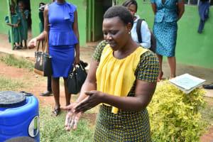 The Water Project: Elufafwa Community School -  Trainer Joyce Demonstrating Handwashing