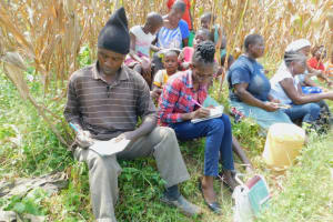 The Water Project: Sichinji Community, Kubai Spring -  Participants Keenly Taking Notes