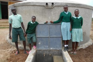 The Water Project: Mukangu Primary School -  Students Pose With Rain Tank