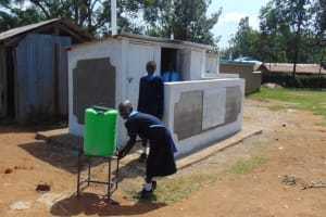 The Water Project: Enyapora Primary School -  Handwashing Outside The Girls Latrines