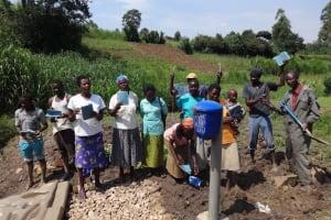 The Water Project: Bungaya Community, Charles Khainga Spring -  Showing Off Training Materials