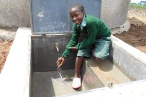 The Water Project: Mukangu Primary School -  Enjoying The Rainwater