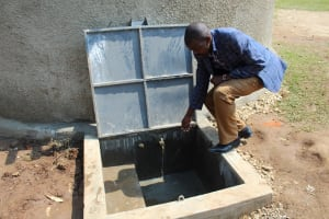 The Water Project: Musasa Primary School -  Staff Checks Out The Tap