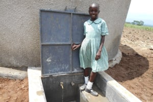 The Water Project: Mukangu Primary School -  Standing Proud With The Rain Tank